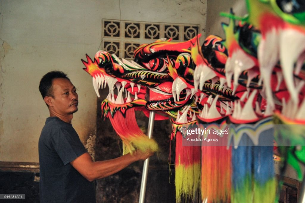 A craftsman inspects the Liong (dragon) costume at home industry costume maker in Bogor  sc 1 st  Getty Images & The making of Liong and Barongsai ahead Lunar New Year Pictures ...