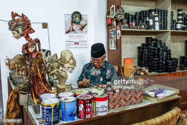 A craftsman is seen painting a puppet of the Ramayana type in Cupumanik Galery Cupumanik Puppets Gallery which was founded in 1970 has exported...
