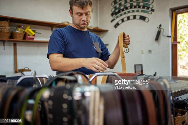 craftsman making new leather belts at the workshop - rubber dress stock pictures, royalty-free photos & images