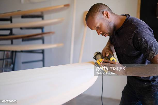 craftsman making paddleboard in workshop - molding a shape stock pictures, royalty-free photos & images