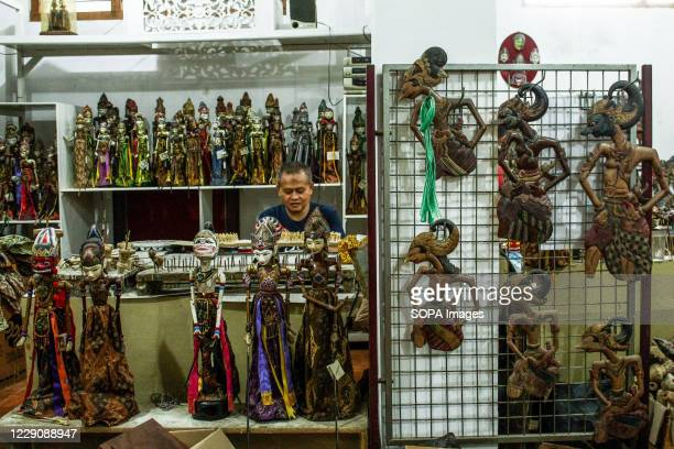 A craftsman painting puppets in Cupumanik Gallery Cupumanik Puppets Gallery which was founded in 1970 has exported puppets of various sizes and...