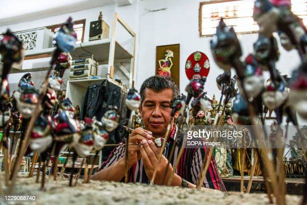 A craftsman paints a puppet in Cupumanik Gallery Cupumanik Puppets Gallery which was founded in 1970 has exported puppets various sizes and shapes...