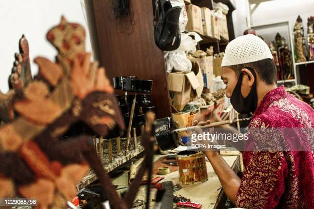 A craftsman paints a puppets in Cupumanik Gallery Cupumanik Puppets Gallery which was founded in 1970 has exported puppets various sizes and shapes...