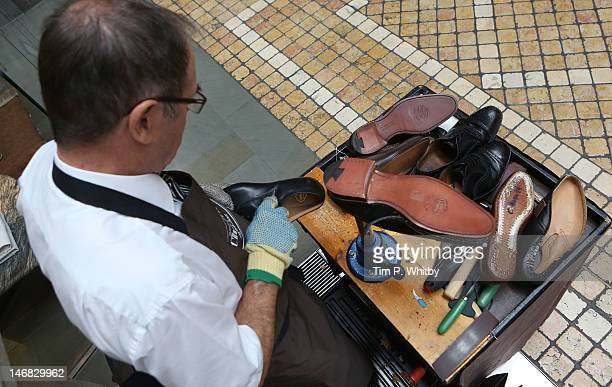A craftsman practising the art of shoe making and repair at The Royal Exchange which played host to some of Britain's most revered craftsmen as they...