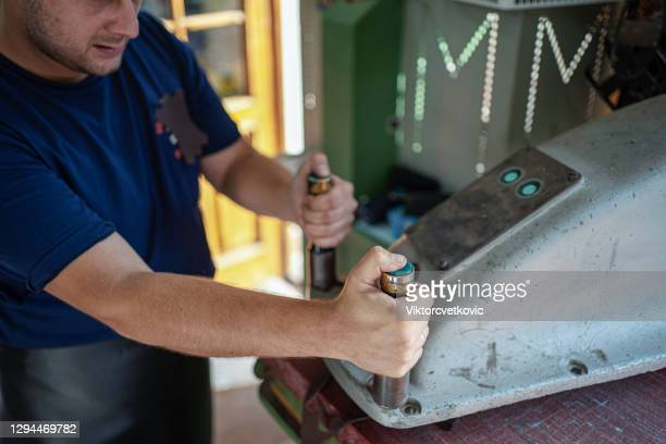 craftsman preparing to make new belts at the workshop - rubber dress stock pictures, royalty-free photos & images