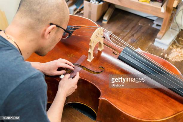 craftsman repairing a double bass - bassoon stock pictures, royalty-free photos & images