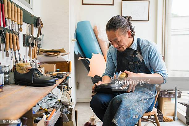 Craftsman repairing or making a pair of shoes