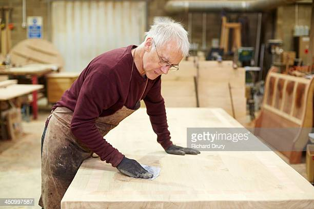 craftsman sanding table in furniture workshop - craftsperson stock pictures, royalty-free photos & images