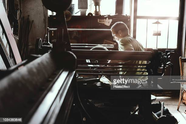 craftsman worker in his workshop - persistence stock pictures, royalty-free photos & images
