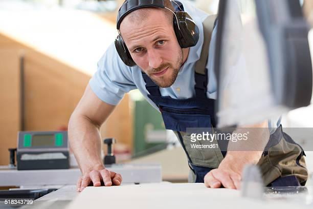 Craftsman working at circular saw