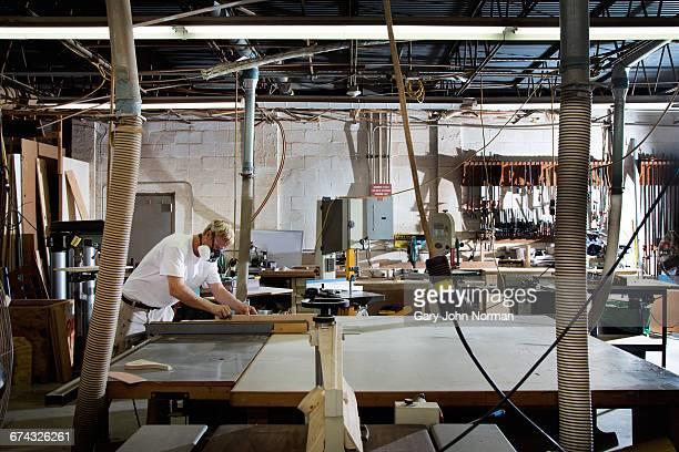 Craftsman working in boatyard workshop