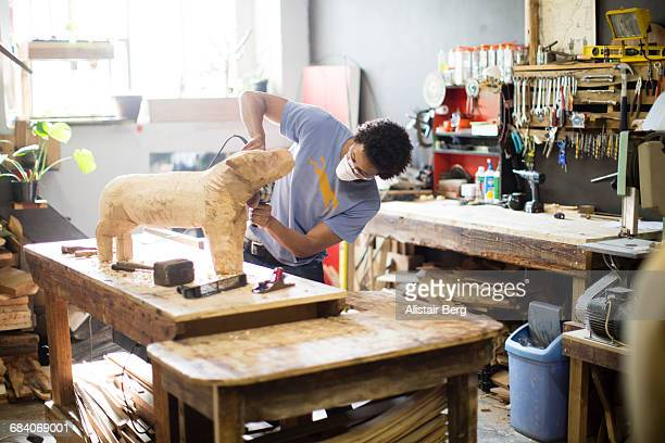 craftsman working in his workshop - sculptor stock pictures, royalty-free photos & images