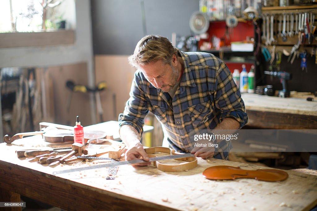 Craftsman working in his workshop : Stock Photo
