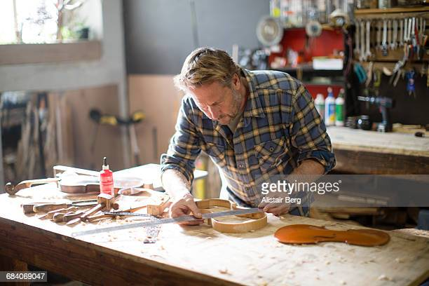 craftsman working in his workshop - instrument maker stock photos and pictures