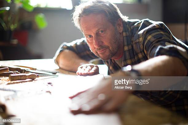 craftsman working in their workshop - craftsperson stock pictures, royalty-free photos & images