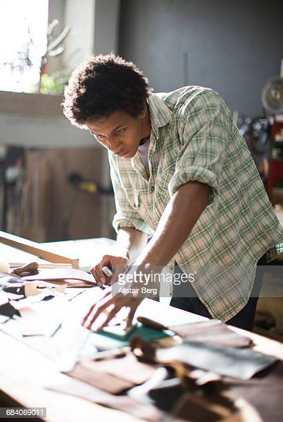 craftsman working in their workshop - leather shirt stock pictures, royalty-free photos & images