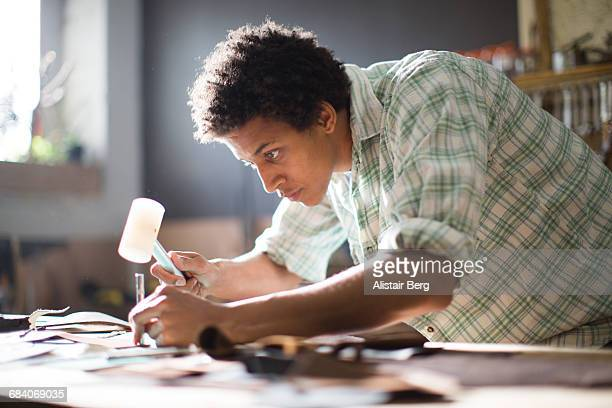 craftsman working in their workshop - craftsman stock photos and pictures