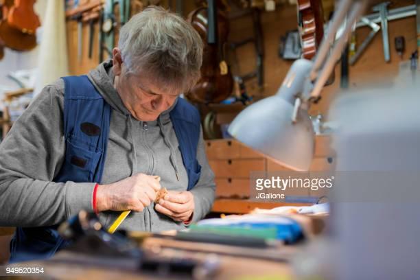 Craftsman working on an antique violin
