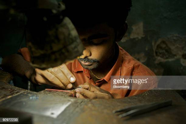 A craftsman works at a diamond finishing and jewelry workshop in Mumbai India on Tuesday Nov 10 2009 Rough diamonds are poised to slide as this...