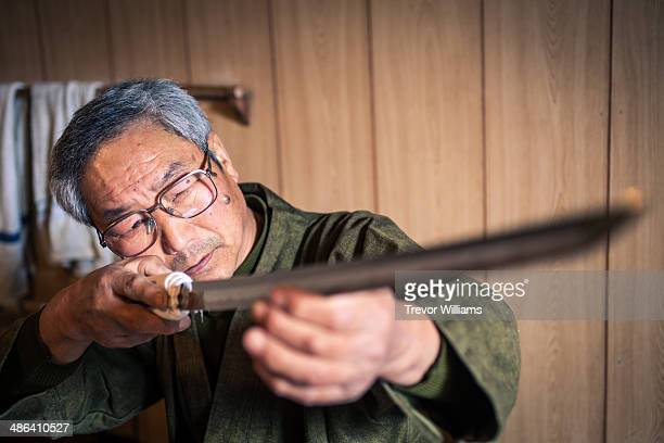 A craftsmen checks a traditional Japanese sword