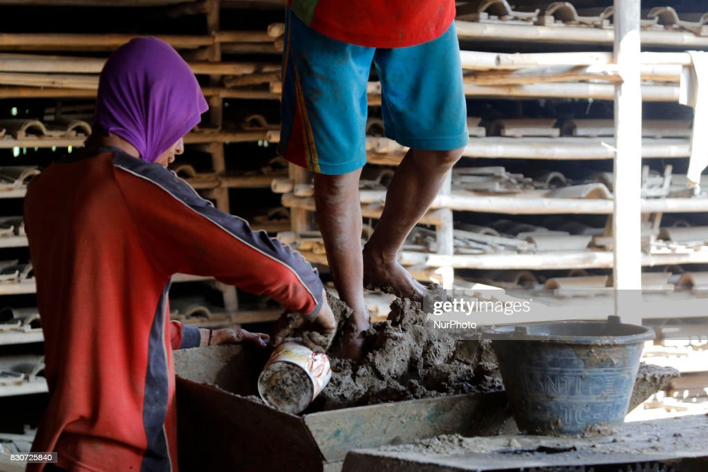 Craftsmen produce tile in Brujul Wetan Village, Majalengka, West Java, on August, 12,2017. When the dry season in a month this traditional factory can make 1,800 to 2,000 units of tile that is usually 4000 units in a month. Difficulties in tile entrepreneurs is from the raw materials of the land that began to be difficult and the existence of modern and lightweight plastic roof tile products sold in the market. Dasril Roszandi