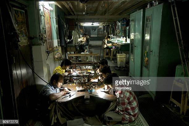 Craftsmen work inside a diamond finishing and jewelry workshop in Mumbai India on Tuesday Nov 10 2009 Rough diamonds are poised to slide as this...