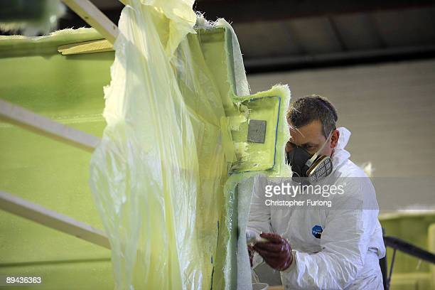Craftsmen work on vehicles in the workshops of ice cream van manufacturers Whitby Morrison on July 28 2009 in Crewe United Kingdom Whitby specialised...