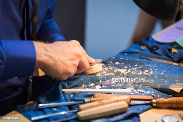 craftsperson carving violin - carving knife stock pictures, royalty-free photos & images