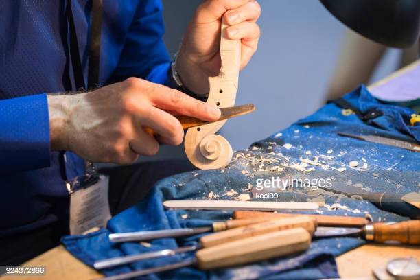 craftsperson hand made violin - carving knife stock pictures, royalty-free photos & images