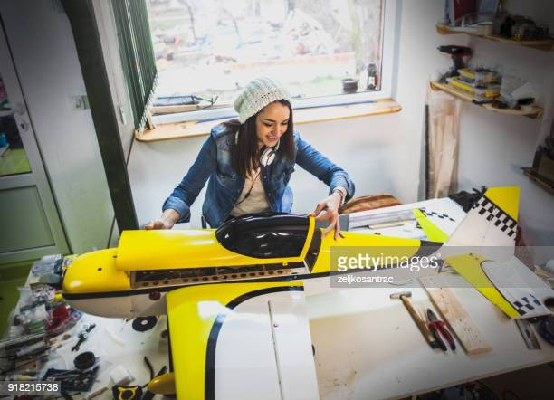 craftsperson making airplane model - model building stock photos and pictures