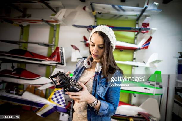craftsperson making airplane model