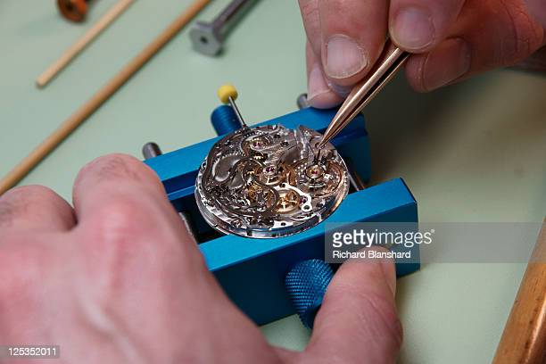A craftsperson used tweezers to adjust a watch at the Montblanc factory circa 2007