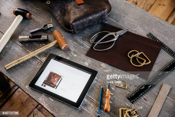 Craftspersons work bench with store website showing on an ipad