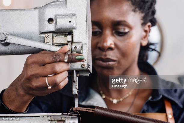craftswoman concentrates whilst using a sewing machine - sewing stock pictures, royalty-free photos & images