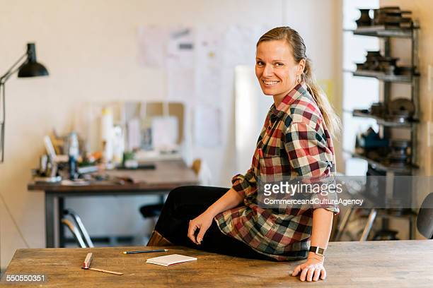 craftswoman in her studio - hair back stock pictures, royalty-free photos & images