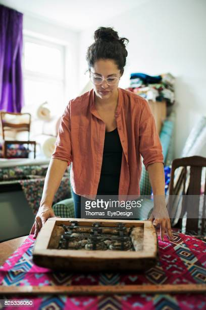Craftswoman Preparing Colorful Fabric for Re-upholstery