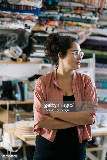 Craftswoman Standing In Colourful Home Workshop
