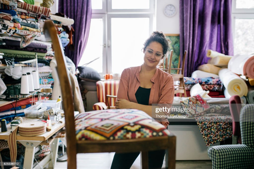 Craftswoman Stands Back To Admire Her Work : Stock Photo