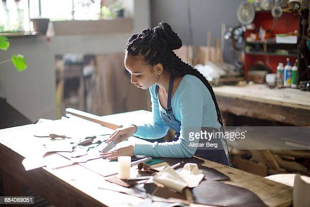 craftswoman working in their workshop - craftsman stock photos and pictures