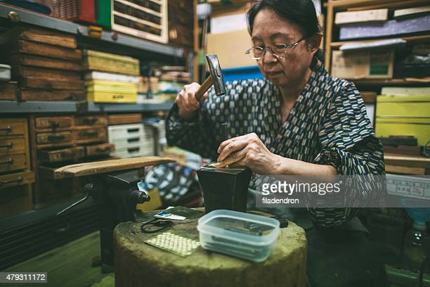 craftswoman working on metal ornaments - craft product stock pictures, royalty-free photos & images