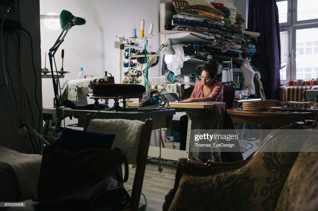 Craftswoman Working On Sewing Machine In Workshop : Stock Photo