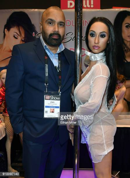Crafty Fantasy CEO Jag poses with the company's new sex doll in the likeness of webcam model and feature dancer Reya Sunshine at the 2018 AVN Adult...