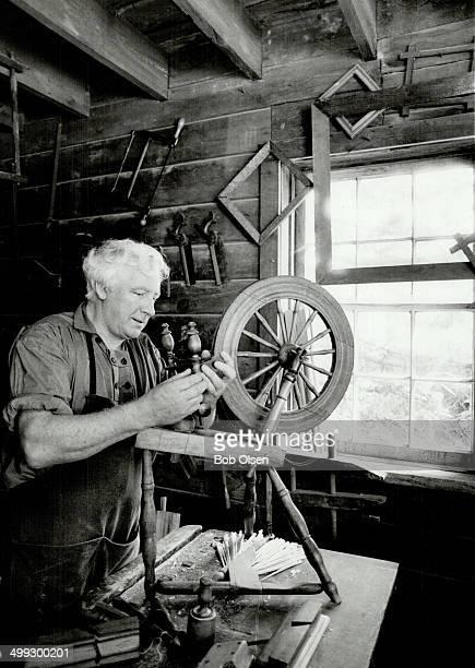 Crafty man Cabinetmaker and woodcarver Bill Jardine repairs a spinning wheel in his shop at Black Creek Pioneer Village