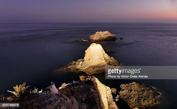 Crag of the Saint (Peñon del Santo) and the mediterranean sea at twilight )  in Alñuñecar, Granada, Spain