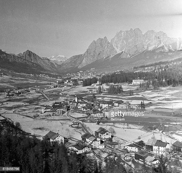 Craggy peaks of the Dolomite Mountains cradle Cortina D'Ampezzo Italy site of the big 1956 Winter Olympic Games This view of the picturesque town is...