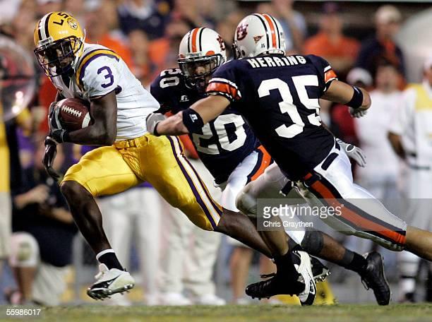 Craid Davis of Louisiana State University rushes past Matthew Motley and Will Herring of Auburn University at Tiger Stadium in Baton Rouge Louisiana...