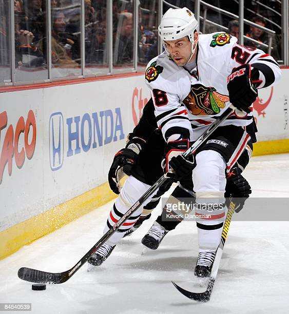 Craig Adams of the Chicago Blackhawks controls the puck against Anaheim Ducks during the first period of the game at the Honda Center on January 28...