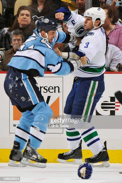 Craig Adams of the Pittsburgh Penguins and Kevin Bieksa of the Vancouver Canucks exchange blows during a first period fight on November 17 2010 at...