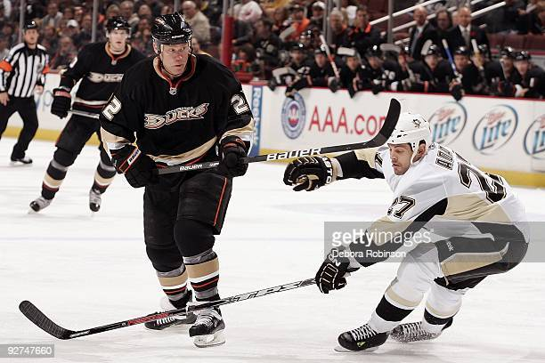 Craig Adams of the Pittsburgh Penguins reaches in front of Todd Marchant of the Anaheim Ducks during the game on November 3 2009 at Honda Center in...