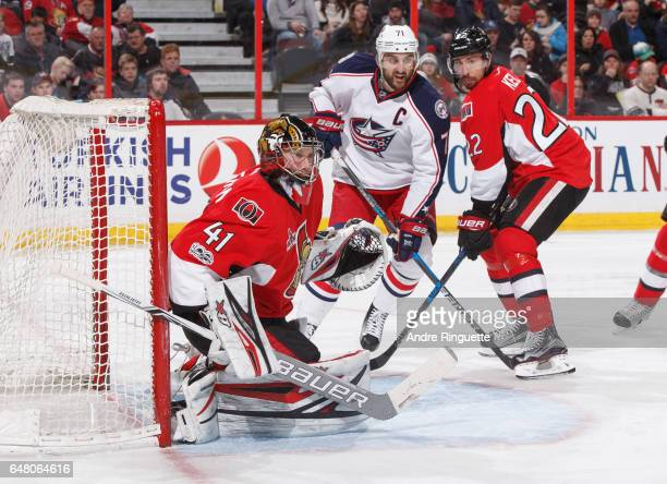Craig Anderson and Chris Kelly of the Ottawa Senators defend against Nick Foligno of the Columbus Blue Jackets at Canadian Tire Centre on March 4...